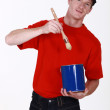 Painter with a pot and brush — Stock Photo