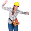 Female builder pretending to be stuck — Stock Photo #11865602