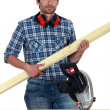 Stock Photo: Carpenter with circular saw