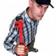 An angry man with a wrench. — Stock Photo #11867473