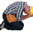 Stock Photo: Construction worker on his knees