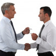 Businessmen shaking hands and exchanging cards — Stock Photo