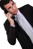 Concerned businessman talking on the phone — Stock Photo