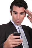 Stunned businessman reading a text message — Stock Photo