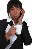 Businesswoman on the phone with a cup of tea — Stock Photo