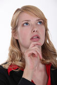 Horrified woman looking up at the sky — Stock Photo