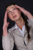 Woman suffering from a throbbing headache — Stock Photo