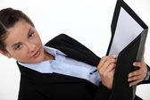 Businesswoman writing in a folder — Stock Photo