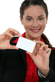 A businesswoman presenting her card. — Stock Photo
