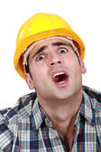 A horrified tradesman — Stock Photo