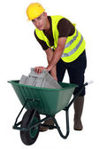 Laborer with a wheelbarrow — Stock Photo