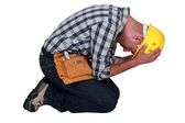Construction worker on his knees — Stock Photo