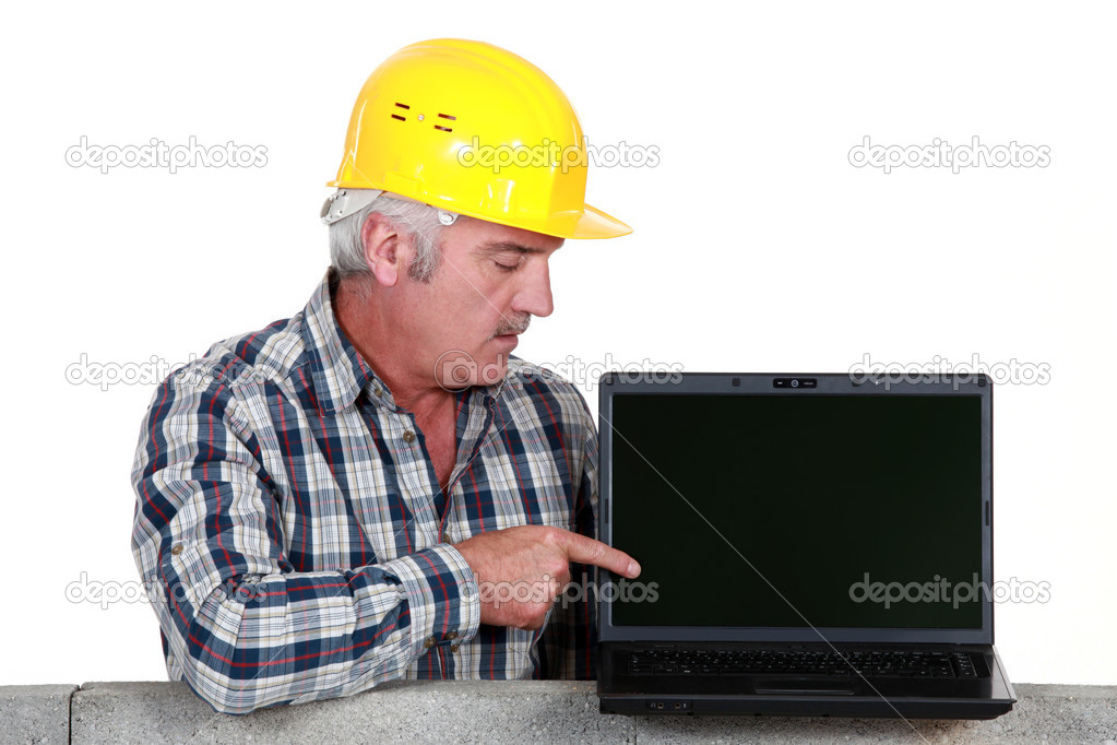 Tradesman pointing to his new laptop — Stock Photo #11866921