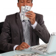 A con man smelling his loot — Stock Photo