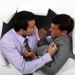 Stock Photo: Two businessmen fighting
