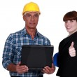 Businesswoman and craftsman posing together — Stock Photo #11874965