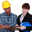 Stock Photo: Architect and foremworking together