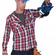 Carpenter stunned at sander machine — Stock Photo #11876104