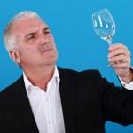 Man examining a wine glass — Stock Photo