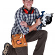 Stock Photo: Carpenter holding circular saw