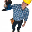 A construction worker sad about his broken drill. — Stock Photo #11879182