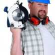 A plumb handyman with a circular saw. - Stock Photo
