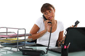 Apologetic secretary on the phone — Stok fotoğraf
