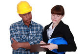 Architect and foreman working together — Stock Photo