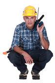 Tradesman squatting — Stock Photo
