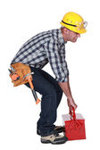 Worker with a heavy tool box — Stock Photo