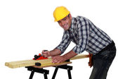 Carpenter working on workbench — Stock Photo