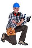 Carpenter holding circular saw — Stock Photo