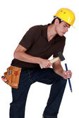 Carpenter concentrating with a hammer and chisel — Stock Photo