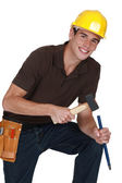 Man hitting chisel with hammer — Stock Photo
