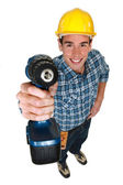 Tradesman holding a power tool — Photo