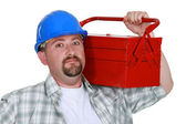 Worker holding too-box over shoulder — Stock Photo