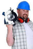 A plumb handyman with a circular saw. — Stock Photo