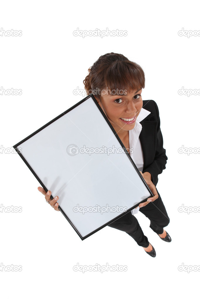 Office worker holding empty picture frame — Stock Photo #11872369