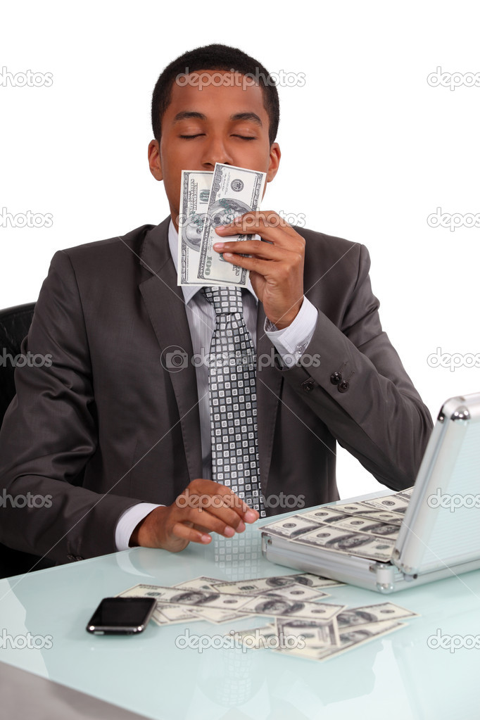 A con man smelling his loot — Stock Photo #11873774
