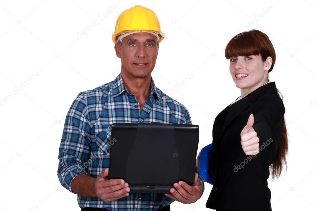 Businesswoman and craftsman posing together  Stock Photo #11874965