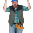Builder losing his mind - Stock Photo