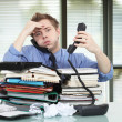 Stock Photo: Office worker overworked