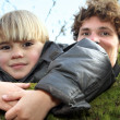 Father and son in the woods — Stock Photo #11880332