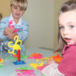 Brother and sister playing a game — Stock Photo #11880444