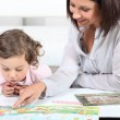 Mother and daughter reading — Stock Photo #11880658