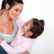 Woman holding her little girl — Stock Photo