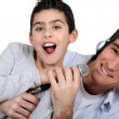 Father and son horsing around — Stock Photo