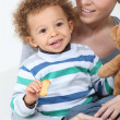 Little boy with teddy and biscuit — Stock Photo