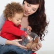 Stock Photo: Little boy grabbing biscuit from jar