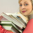 Woman with pile of books — Stock Photo